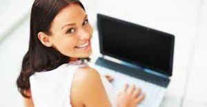 larger image happy brunette woman at computer